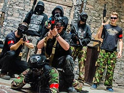 A group of people holding airsoft rifles
