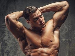A topless man, posing