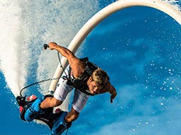 A man flyboarding in the air