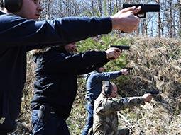 A group of men aiming guns