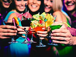 A group of girls holding cocktails