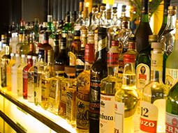Image of a selection of spirits behind a bar