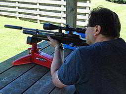 A man aiming with an air rifle
