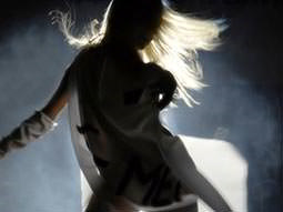 Smoky silhouette of a woman dancing