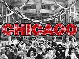 The word Chicago in red glitter and over a black and white image of people dancing