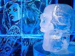 A woman carved into the wall at ICEBAR, London, and an ice skull sculpture