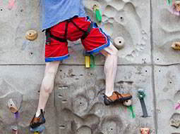 A man on a climbing wall