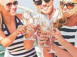 A group of people clinking champagne glasses together and smiling