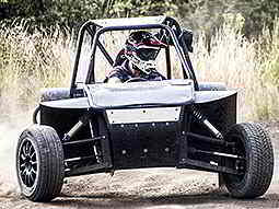 Man driving a Rage Buggy through a woodland area