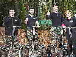 Four people on segways in a forest