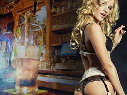 A woman in white and black underwear, over a faded image of a half pint on a bar top