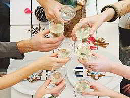 Seven women toasting with full champagne flutes