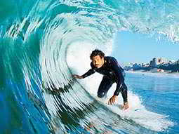 A man riding on a massive wave