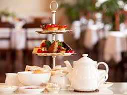 A high tea laid out in a sophisticated looking restaurant