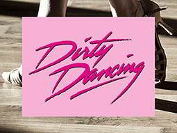 Pink Dirty Dancing text on a pink background, over an image of a man and woman's feet as they dance