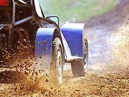 Some wheels going quickly through mud