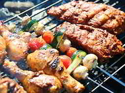 Meat skewers on a bbq grill