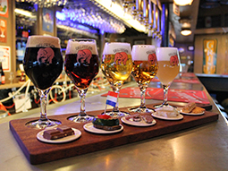 Four sample beers in a sampling rack