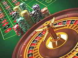 A roulette wheel with chips and the board in the background