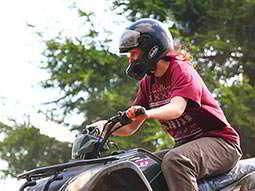 A woman driving a quad bike