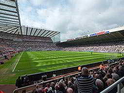 A view of St James Park pitch and stands from the bottom of the Gallowgate stand