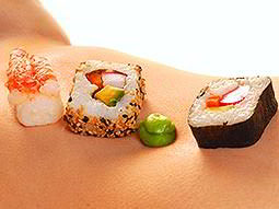Pieces of sushi resting on skin