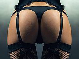 A woman's bum in a thong and suspenders