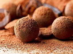 Some chocolate truffles dusted in coco powder