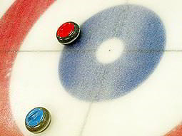 Close up two discs on an ice curling track