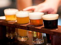 Close up of four craft beers in a rack