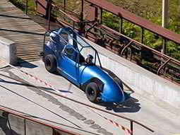 A blue bobsleigh ready to travel down an outdoor slope