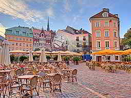 Outdoor seating in the Old Town centre of Riga, with buildings in the background
