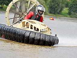 A hovercraft making a turn on the surface of some water