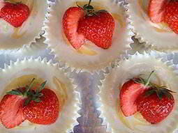 Some delicate cakes with strawberries on the top