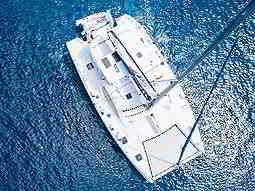 A bird's eye view of a catamaran boat on the ocean