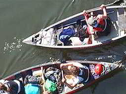 Birds' eye view of people sitting in canoes