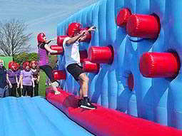 People climbing on the Punch Wall