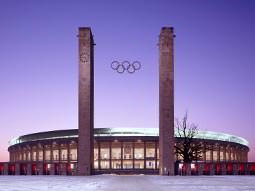 The front of the Olympic Stadium, Berlin, with the Olympic logo between two towers