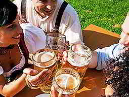 People toasting with steins