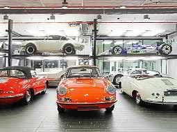 Multiple Porsche sports cars on display in the Porsche museum