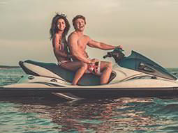 A man and a woman on a speedboat