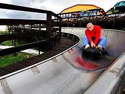 A man coming down a track on a bobsleigh