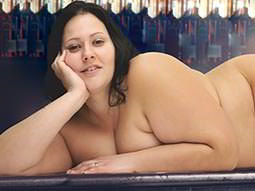 A fat woman posing naked