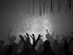 Silhouettes of people in a club