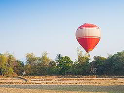 A red hot air balloon on the ground