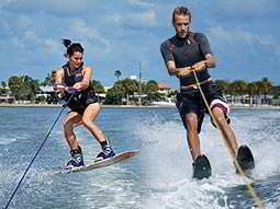A man and woman wakeboarding on water