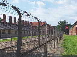 A view down a barbed wire fence at a concentration camp