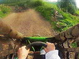 Three mud buggies driving through the countryside