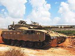 A main battle tank on a dirt track