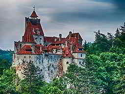 Bran Castle surrounded by dense woodland